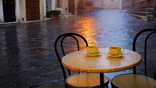 depositphotos_185005828-stock-video-rainy-day-street-cafe-scene.jpg
